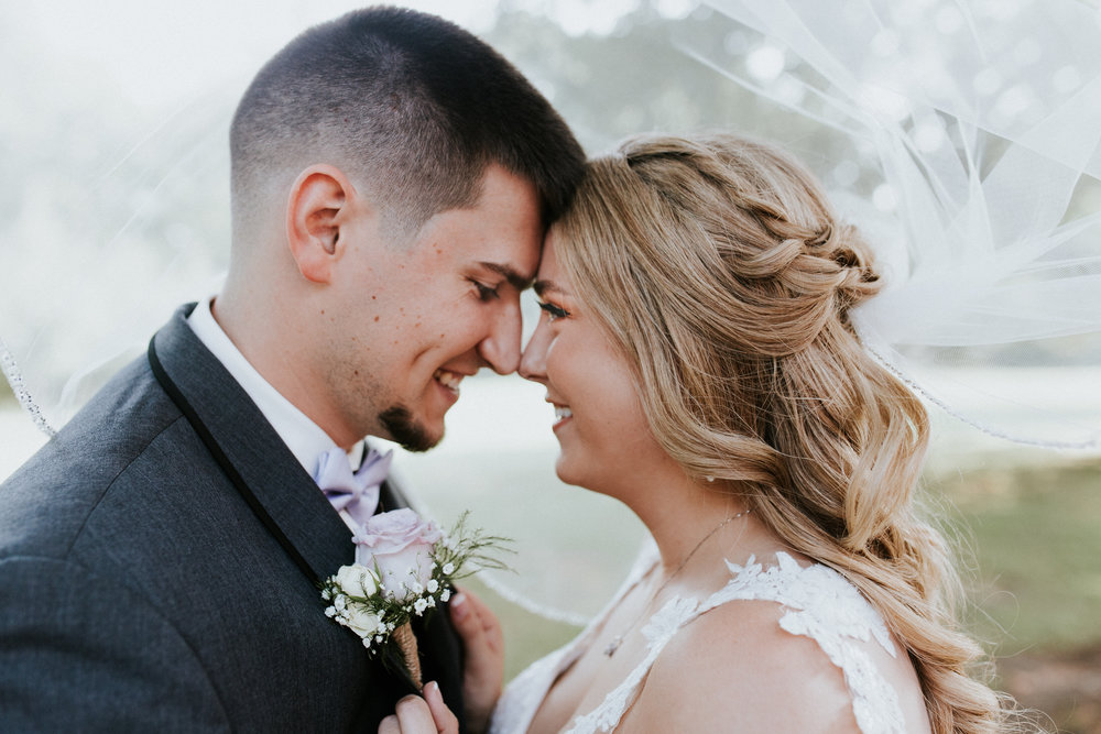 "Jake & Raeschelle - ""She beautifully captured our day. She was very easy to work with, even when some family and bridal party members weren't! Katelyn perfectly captured mine and my husbands personality in all of photos."""