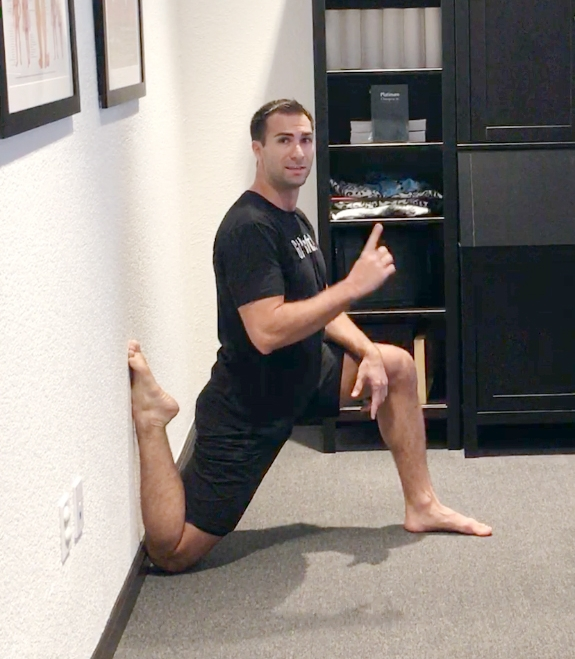 Dr. Karo demonstrating the couch stretch. Go to our Facebook Group for the full video.