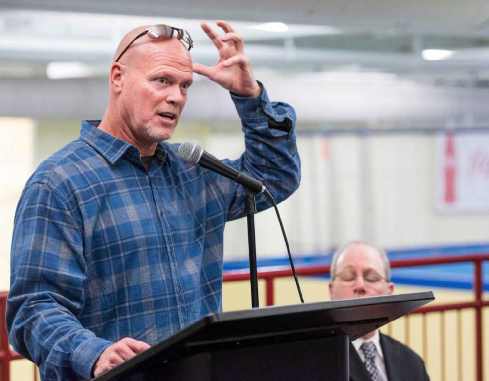 Jim McMahon, former Chicago Bears quarterback, speaks to an audience at Chelsea Piers Stamford, CT about being a patient of Dr. Scott Rosa, a cranio-cervical specialist, and Dr. Rosa's procedure on treating cranio-cervical issues. Thursday, January, 16th, 2014. Photo: Mark Conrad