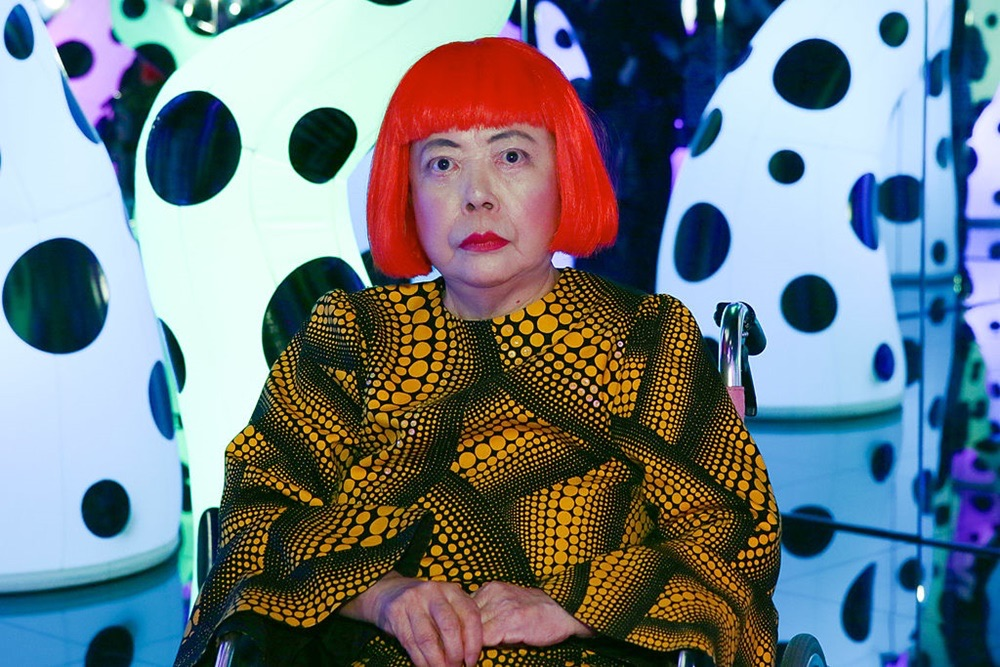 """Yayoi Kusama at her show """"I Who Have Arrived In Heaven,"""" at David Zwirner Gallery in 2013. Photo Andrew Toth/Getty Images."""