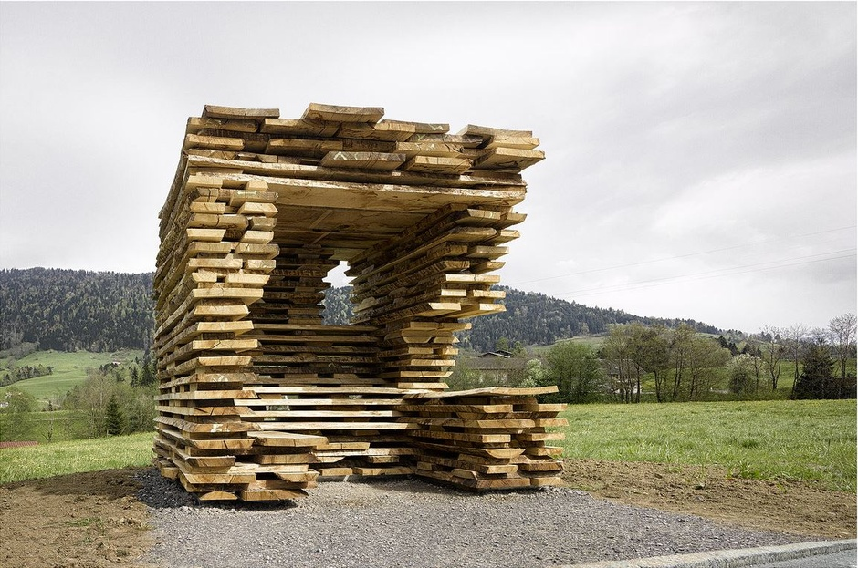 Ensamble Architects creates a shelter constructed in the traditional local method of storing wood to dry, prior to utlising for building. (Photo by Adolf Bereuter)
