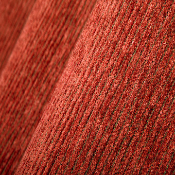 CHENILLE |  A fuzzy, caterpillar-like yarn of either cotton or man-made fibres, produced by locking short, cut fibres at right angles to the core thread. Fabric woven with chenille yarn in the weft, producing a cut-pile surface.
