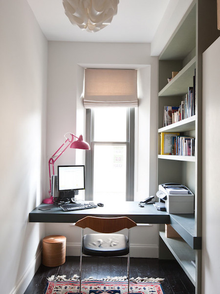 luxurious-home-office-with-built-in-desk-dark-wood-flooring-trash-can-white-pendant-light-built-in-shelves-desk-window-and-small-persian-rug.jpg