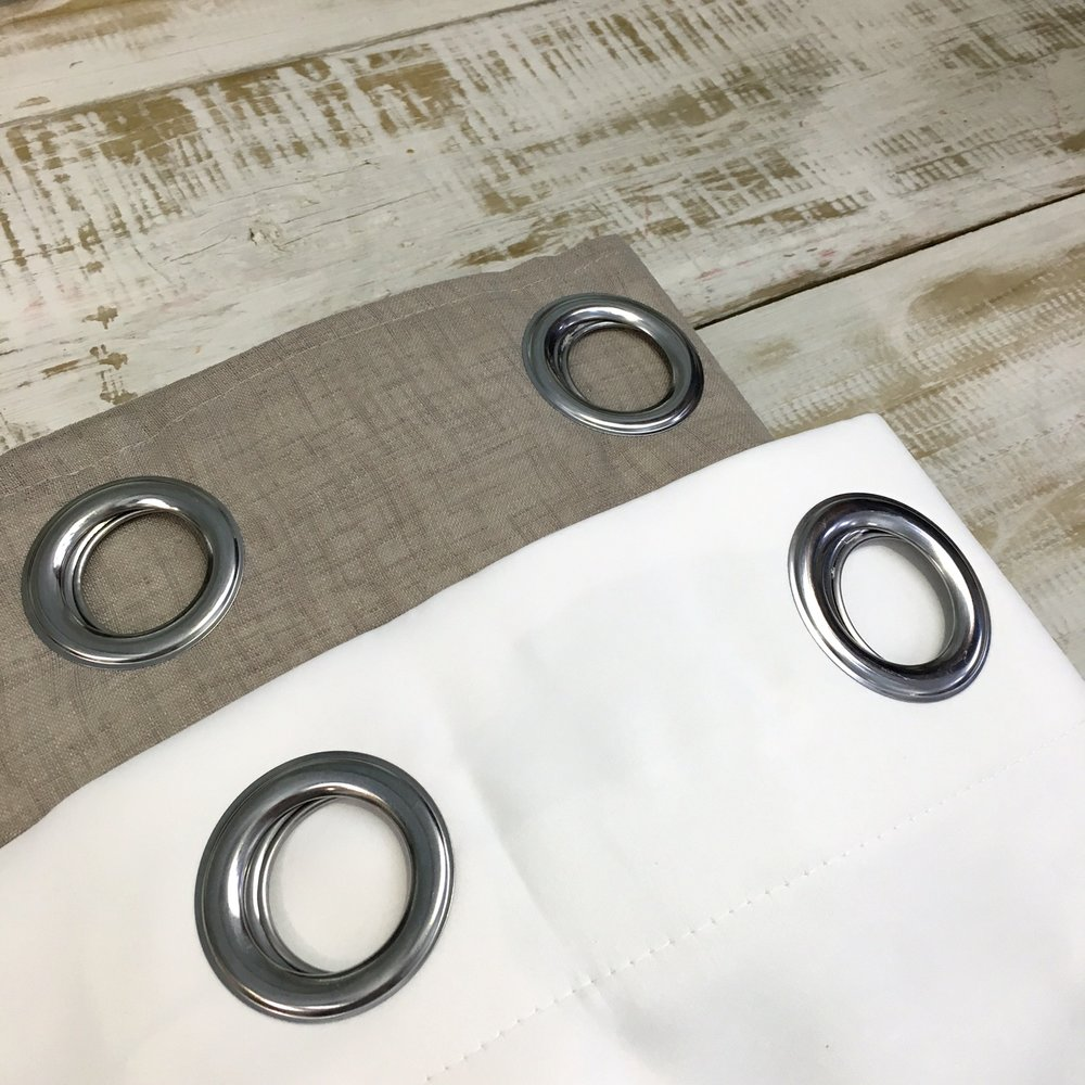 STEP 2 - Lay your existing ready-made curtain face down on a clean, flat surface. Lay the black out lining eyelet on top.