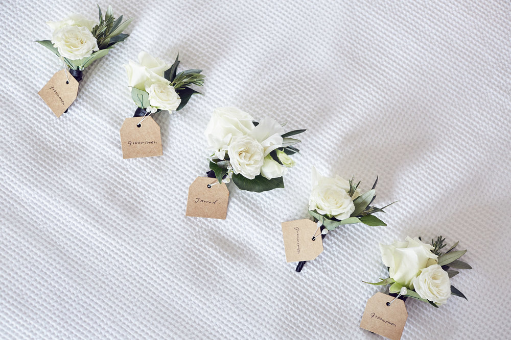 Groomsmen boutonieres by Sugarbee Flowers