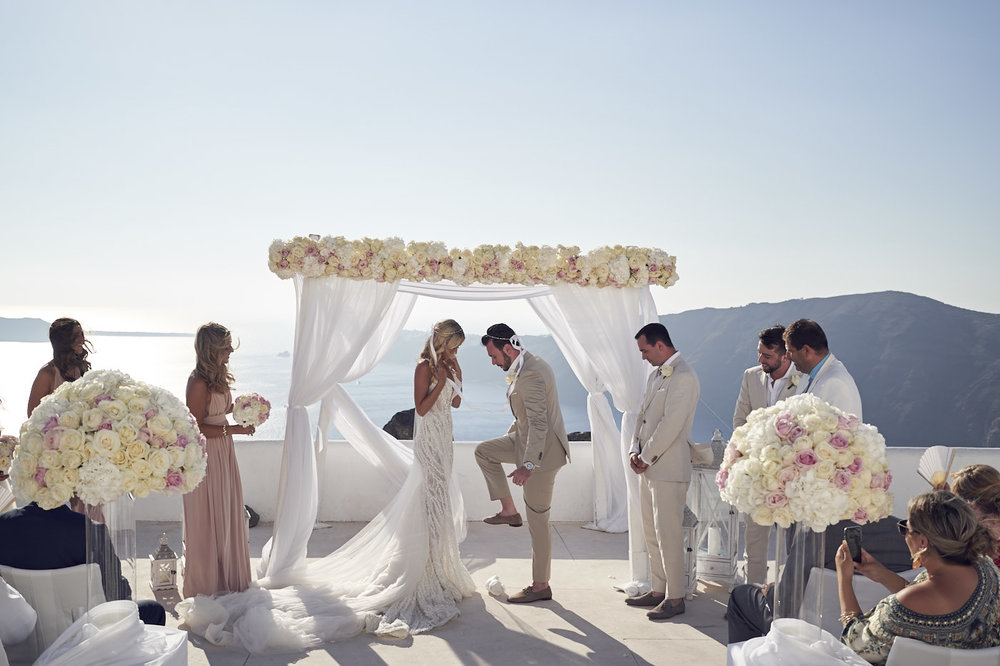 Beautiful Santorini Wedding at rocabella. Pallas Couture. Breaking the glass. Jewish-Greek wedding. Lost In Love Photography