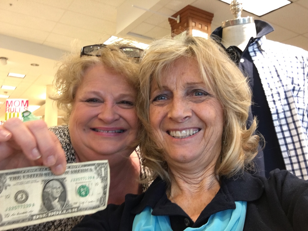 Mrs. Jean-Wray Cannady Gives Ms. Becky a Jesus dollar during her shopping trip at Belk.