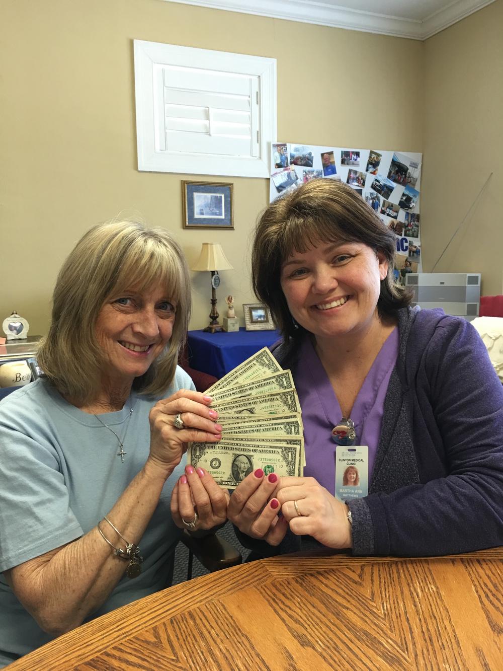 Ann Matthews brings jesus dollars to tim's gift.
