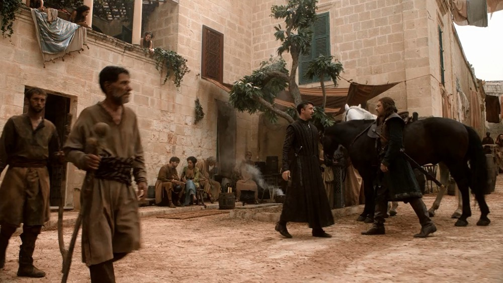 """Littlefinger meets Ned Stark in front of his pleasure house in S01S03 episode """"Lord Snow"""""""