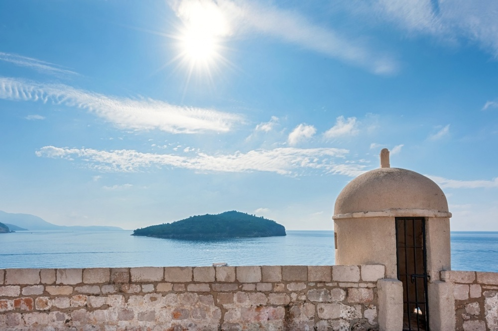 dubrovnik-weather-and-climate-gun-turret-on-old-city-walls-of-dubrovnik-city--croatia-with-island-lokrum-in-background-445-cba7.jpg