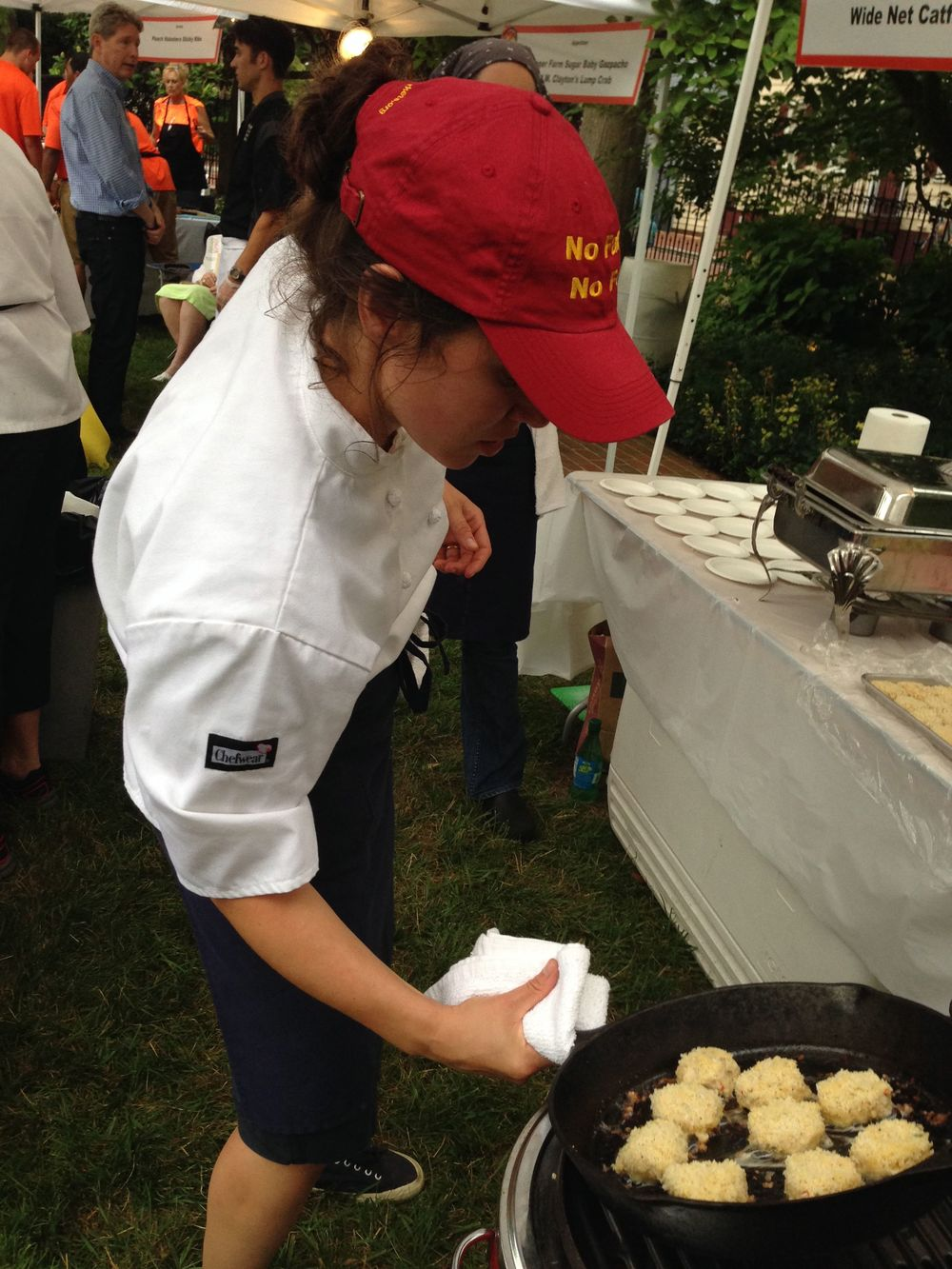 Chef Emily Hagel, of Miriam's Kitchen cooking blue catfish cakes. MK aims to end chronic homelessness in Washington, D.C.