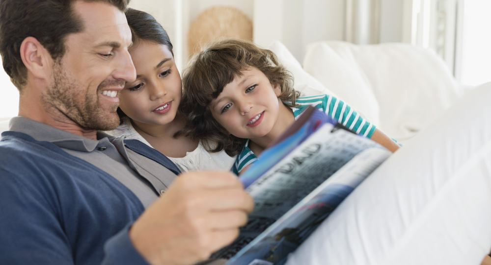 man-reading-a-magazine-with-his-children-2-min.jpg