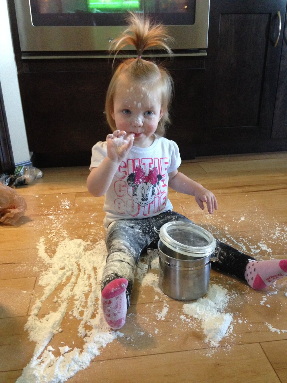 My niece Lauren (age 2.5 at the time) discovering powdered sugar is fun to make art with and also quite delicious!