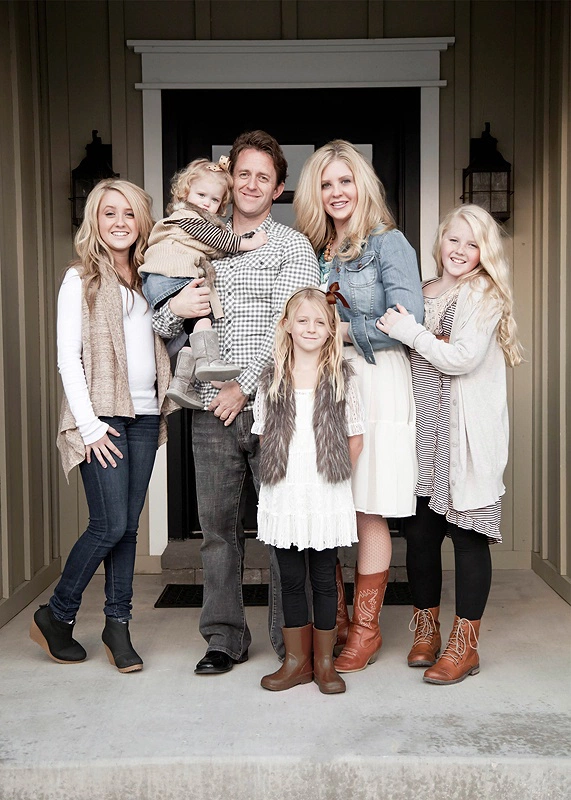 This family has nailed the layers concept. Mom & daughters all have multiple layers and textures on, but because they are all in the same neutral color theme, it doesn't seem like too much. It's also fun that they are posing on their front porch.   |   Photo Credit:  shannamichellephotography