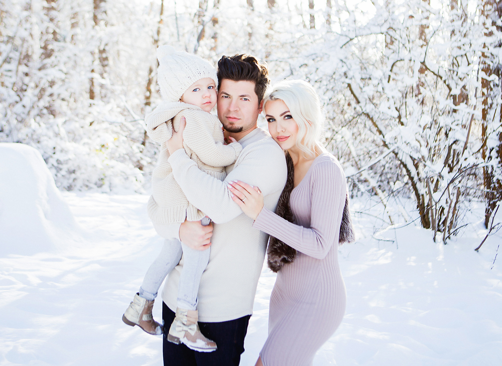 In this shoot, there could have been more contrast between the snowy background and the daughter's and father's outfit choices, as they blend in with the scenery.  |   Photo credit:  http://www.purelylily.com