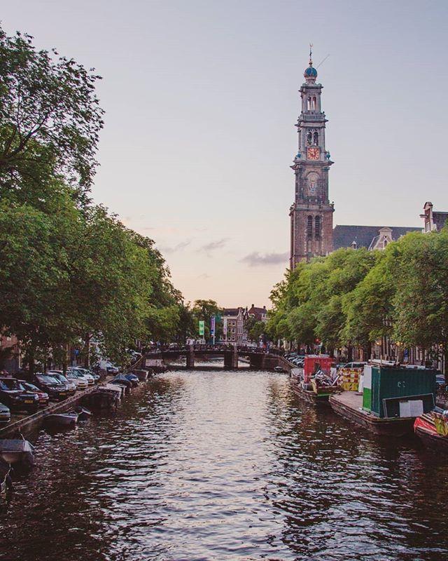 I could sit forever and watch the sunset over the canals of Amsterdam. . . . . . . . . . _______________________________#themeanwhilemovement #adventureday #adventuregram #aroundtheworld #globelletravels #passportlife #dreamdestination #adventureculture #somuchtosee #howitravel #mybudgettravel #globetravel #sharetravelpics #travelingourplanet #aplacetoremember #guardiantravelsnaps #worldvacations #youmustsee #letsgetlost #travellover #letstraveltoday #athomeintheworld #femmetravel #travelingram