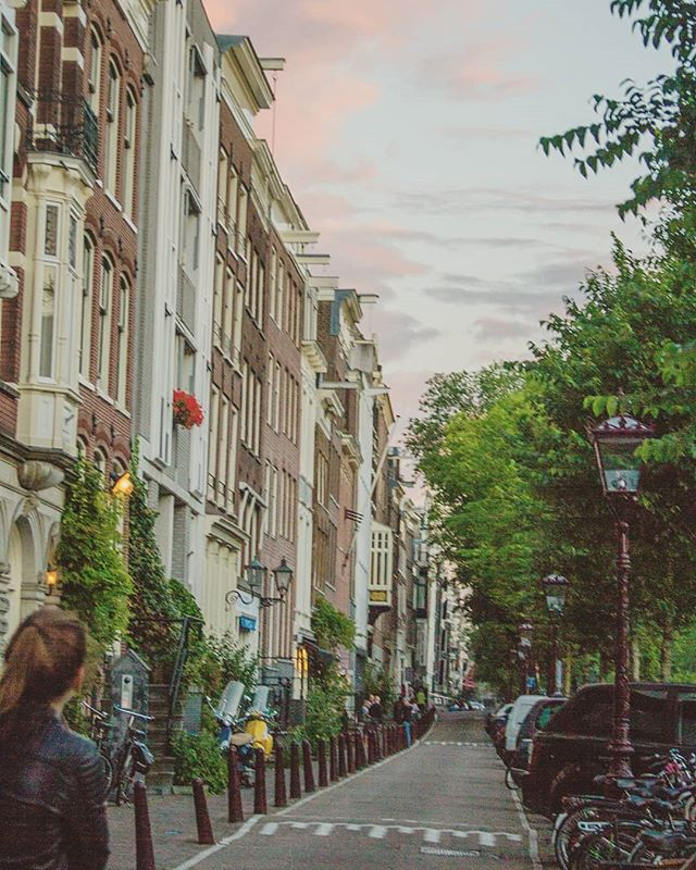 This is probably my favorite picture from my time in Amsterdam.  It takes me back to being in that moment. That's what pictures are for, right? @astridklein . . . . . . . . ____________________________ #themeanwhilemovement #adventureday #adventuregram #aroundtheworld #globelletravels #passportlife #dreamdestination #adventureculture #somuchtosee #howitravel #mybudgettravel #globetravel #sharetravelpics #travelingourplanet #aplacetoremember #guardiantravelsnaps #worldvacations #youmustsee #letsgetlost #travellover #letstraveltoday #athomeintheworld #femmetravel #travelingram #sunset #happyeaster #amsterdam #netherlands #cottoncandysunset