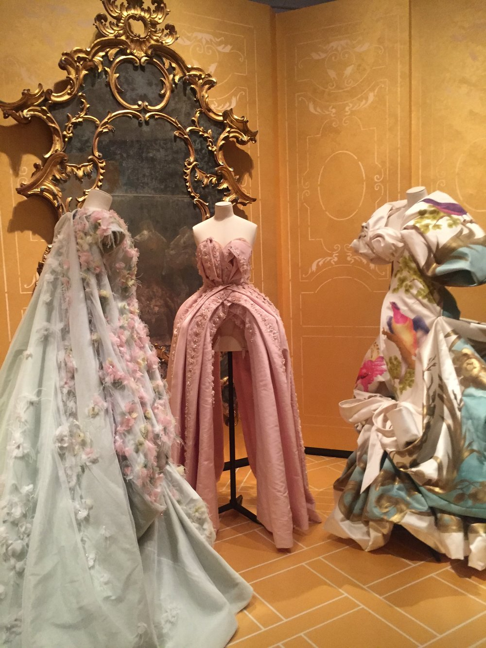 Dior was a fan of 18th century French design and his beloved Granville garden home. Each designer display their interpretations by using 3-D flowers, pastel hues, and delicate fabrics