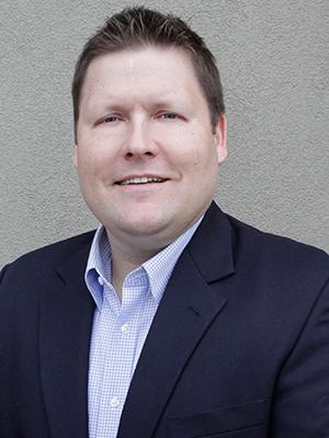 JEREMIAH RHINE, SENIOR VP OF BUSINESS OPERATIONS & FINANCE