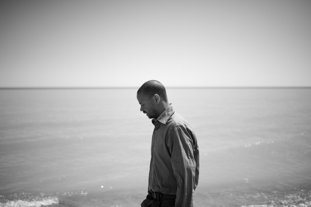 KHARY.   When asked where he wanted to be photographed, Khary chose the shore of Lake Michigan - as he feels it represents the vastness of the loss of his mother, who committed suicide when he was just a baby.