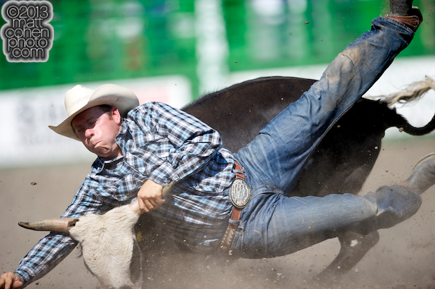 Steer wrestler Timothy Hayes of Dunnigan, CA has some trouble with his steer at the Livermore Rodeo in Livermore, CA.