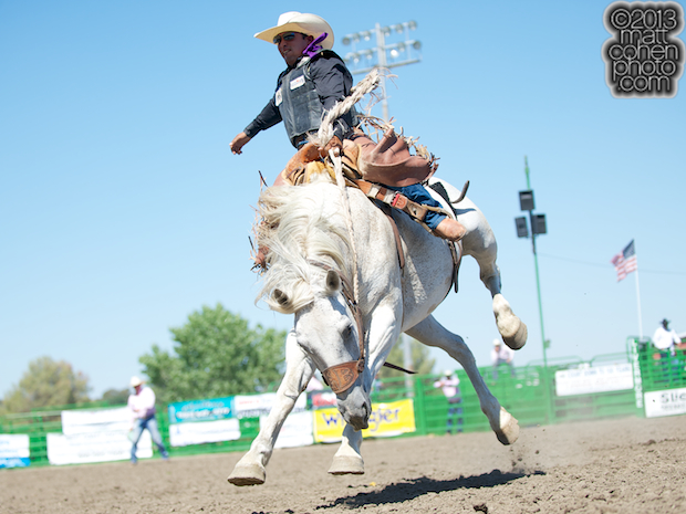 Saddle bronc rider Joaquin Real of Woody, CA rides Crooked Creek at the Livermore Rodeo in Livermore, CA.