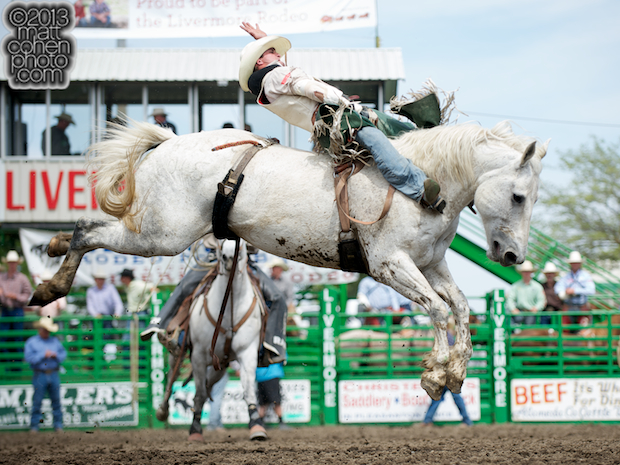 Bareback rider Jared Smith of Cross Plains, TX rides Wild & Blue at the Livermore Rodeo in Livermore, CA.