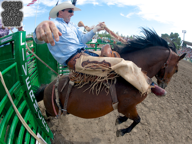 Saddle bronc rider Nick LaDuke of Livermore, CA rides Riddle Me This at the Livermore Rodeo in Livermore, CA.