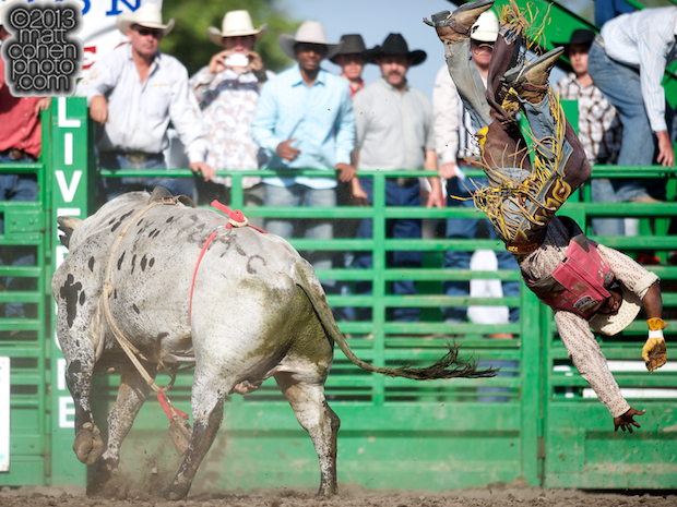 Bull rider Christopher Byrd of Compton, CA gets bucked off Inside Out at the Livermore Rodeo in Livermore, CA.