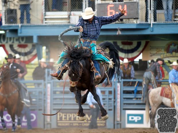 Saddle bronc rider Isaac Diaz of Desdemona, TX rides Nasty Jackie at the Reno Rodeo in Reno, NV.