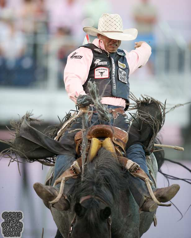 Saddle bronc rider Bradley Harter of Weatherford, TX rides Bordello Blues at the Reno Rodeo in Reno, NV.