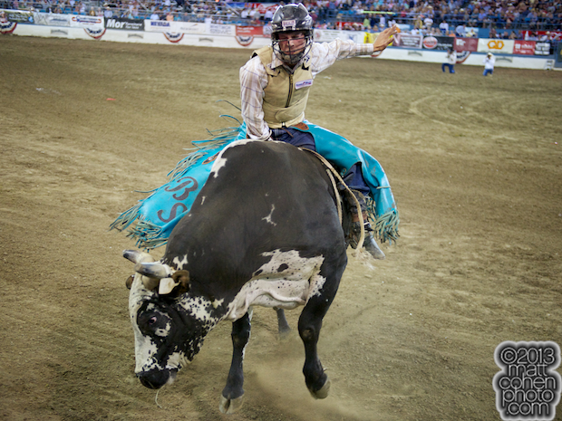 Bull rider Brett Stall of Detroit Lakes, MN rides Big Jake for 89 points and the win at the Reno Rodeo in Reno, NV.