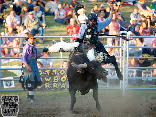 Bull rider Ty Yates of Bakersfield, CA rides 955 at the Marysville Stampede in Marysville, CA.