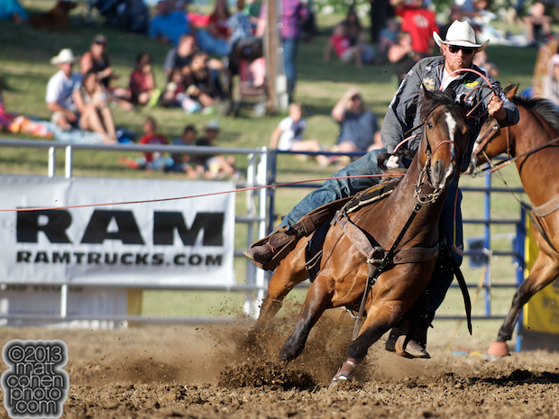 Team roper Spencer Mitchell of Colusa, CA competes at the Marysville Stampede in Marysville, CA.