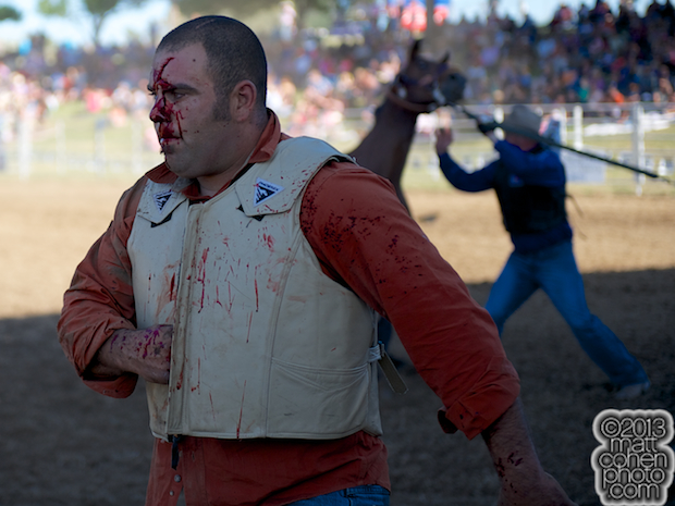 Paul Bianchi walks away bloody after the team bronc riding at the Marysville Stampede in Marysville, CA.
