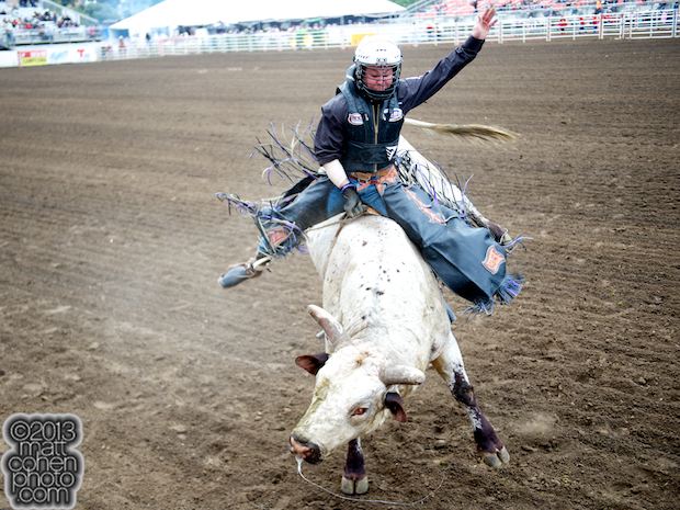 Bull rider Trey Benton III of Rock Island, TX rides Johnny Ramone for 88 points at the California Rodeo in Salinas, CA.