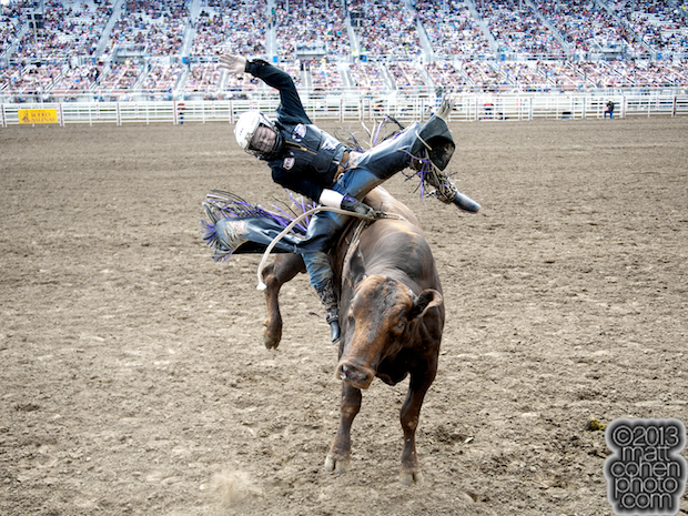 Bull rider Trey Benton III of Rock Island, TX rides Wild Eyes for 89 points and the average win at the California Rodeo in Salinas, CA.