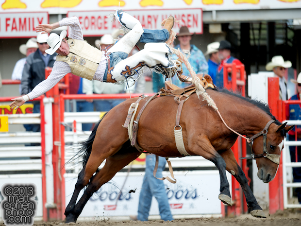 Saddle bronc rider Bryan Hammons of Victoria, TX gets bucked off No Angel at the California Rodeo in Salinas, CA.