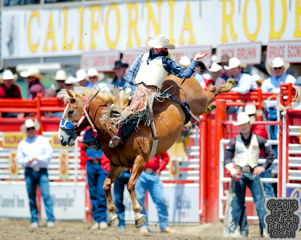 Bareback rider Ryan Gray of Cheney, WA rides Little Hank for 84 points and the average win at the California Rodeo in Salinas, CA.