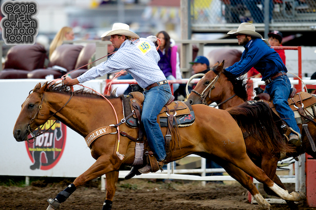 Team ropers Spencer Mitchell and Dakota Kirchenschlager compete at the California Rodeo in Salinas, CA.