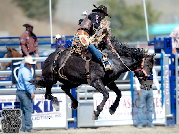 Saddle bronc rider Chuck Schmidt of Keldron, SD rides Professionals Choice at the Rancho Mission Viejo Rodeo in San Juan Capistrano, CA.