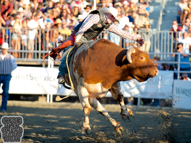 Bull rider Cheyne Olney of Toppenish, WA takes a re-ride at the Rancho Mission Viejo Rodeo in San Juan Capistrano, CA.
