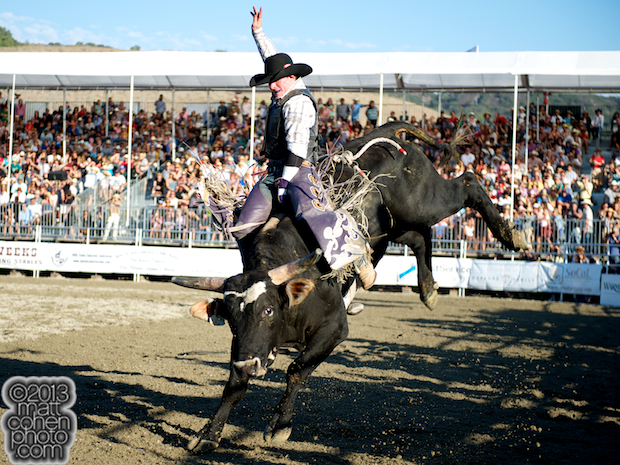 Bull rider Steve Woolsey of Payson, UT rides Justin Boots at the Rancho Mission Viejo Rodeo in San Juan Capistrano, CA.