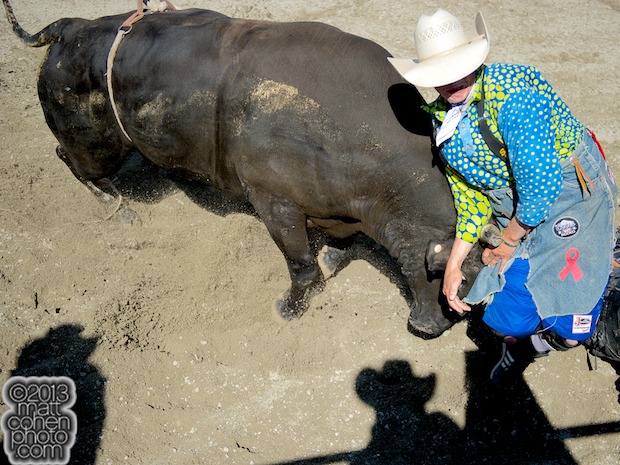 Bullfighter Chance Jackson battles Mad Money at the Rancho Mission Viejo Rodeo in San Juan Capistrano, CA.