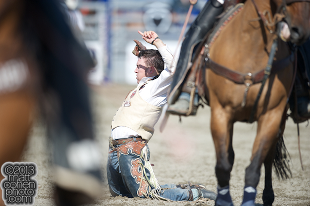 Bareback rider Steven Peebles of Redmond, OR celebrates his day wain at the Rancho Mission Viejo Rodeo in San Juan Capistrano, CA.