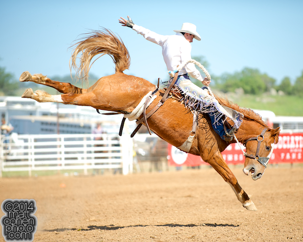 Saddle bronc rider Quincy Crum of Little Valley, CA competes at the La Grange Rodeo in La Grange, CA.