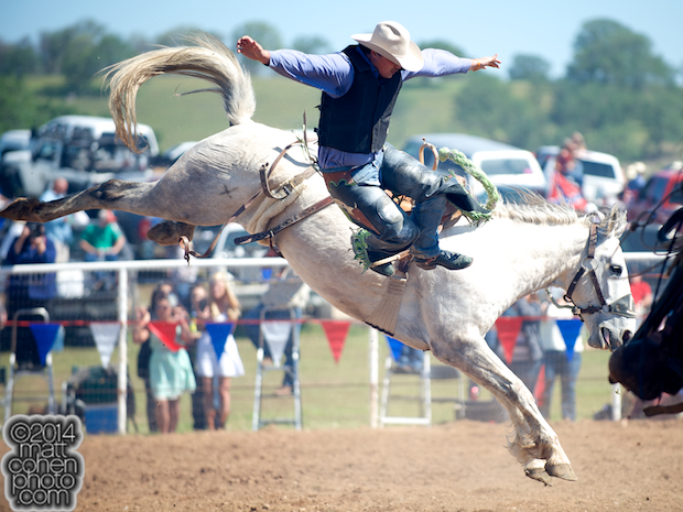 Saddle bronc rider John Giacone of Kerman, CA competes at the La Grange Rodeo in La Grange, CA.