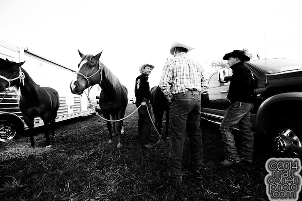 Billy Bugenig talks with some fellow steer wrestlers.