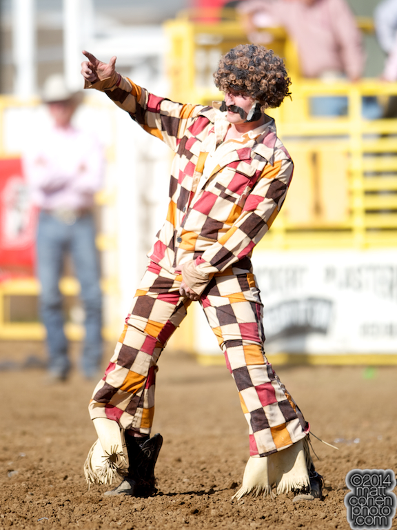 Mert Bradshaw of Eagle Point, OR dressed as Disco Sleaze competes in the Wild Ride at the Red Bluff Round-Up at the Tehama District Fairgrounds in Red Bluff, CA.