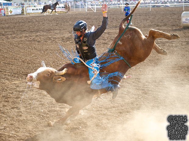 Bull rider Ty Yates of Bakersfield, CA rides Mr Big at the Red Bluff Round-Up at the Tehama District Fairgrounds in Red Bluff, CA.